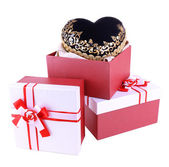Stack of gift boxes and decorative heart, isolated on white — Stock Photo