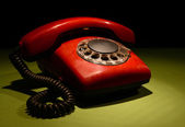 Red retro telephone on dark color background — Stock fotografie