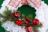 Christmas wreath on fabric background — Stock fotografie