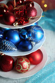 Christmas decorations on dessert stand, on bright background — Stock Photo