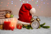 Composition with plaids, candles and Christmas decorations, on white carpet on bright background — Fotografia Stock