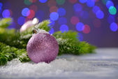 Christmas decorations on wooden table, on bright background — Stock Photo