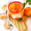 Orange jam with zest and tangerines, on white wooden table — Stock Photo #37163693