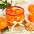 Orange jam with zest and tangerines, on white wooden table — Stock Photo #37163703