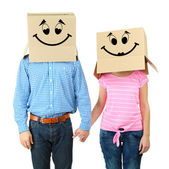 Couple with cardboard boxes on their heads isolated on white — Photo