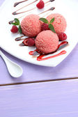 Delicious ice cream on plate on table close-up — Stock Photo