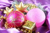Beautiful Christmas decor on purple satin cloth — Foto de Stock