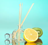 Aromatic sticks for home with fruity odor on blue background — Stok fotoğraf