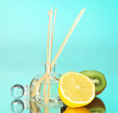 Aromatic sticks for home with fruity odor on blue background — Stock Photo