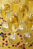 Glasses with champagne on shiny background — Stock fotografie