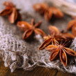 Star anise on wooden background — Stock Photo