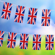 Garland of flags on bright background — Stock Photo