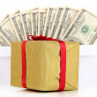 Gift box with money isolated on white — Stock Photo