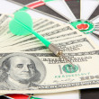 Dart on dartboard and money close up. Concept of success. — Stock Photo