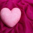 Decorative pink heart, on color fabric, isolated on white — Stock Photo