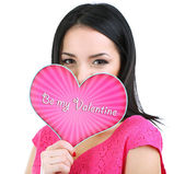 Attractive young woman with Valentine card isolated on white — Stock Photo