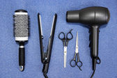 Hairdressing tools on blue background — Stock Photo