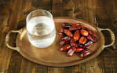 Conceptual photo of Ramadan food:dates and water — Stock Photo