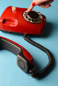 Red retro telephone,on color background — Stock Photo