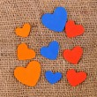 Stock Photo: Hearts made of felt on sacking background