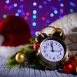 Composition with retro alarm clock and Christmas decoration on bright background — Stock Photo