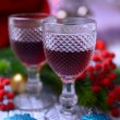 Stock Photo: Wine glasses and Christmas decorations on bright background
