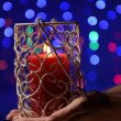 Candle in hand on blur lights background — Stock Photo #37261895