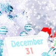 Stock Photo: Calendar with New Year decorations on winter background