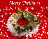 Christmas wreath on fabric background — Photo