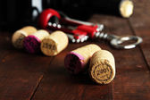 Wine corks with corkscrew on wooden table close-up — Stock Photo