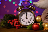 Wine glasses, retro alarm clock and Christmas decoration on bright background — Photo