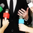 Conference meeting microphones and businessman — Stock Photo #37285837