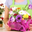 Florist makes flowers bouquet — Stock Photo #37286459