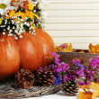 Stock Photo: Beautiful autumn composition in pumpkin with bumps and decorative box on table on wooden background
