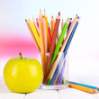 Colorful pencils in glass on wooden table on bright background — Stock Photo #37288071