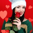 Attractive young woman with heart on Valentine Day — Stockfoto