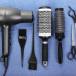 Stock Photo: Hairdressing tools on blue background