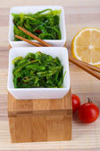 Sea kale in bowls close-up on napkin — Stock Photo