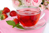 Delicious strawberry tea on table close-up — Стоковое фото