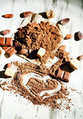 Cocoa powder on wooden table — Stock Photo