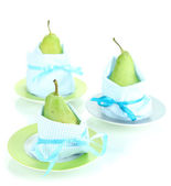 Pears in napkins on plates isolated on white — Stock Photo