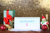 Calendar, New Year decor and fir tree on shiny golden background — Stock Photo