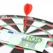 Dart on dartboard and money close up. Concept of success. — Stock Photo #37290693