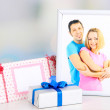 Stock Photo: Gift with card for loved one on table on room background