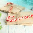 Christmas candy canes and letters for Santa, on color wooden background — Stock Photo