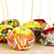 Candied apples on sticks on wooden table close up — Stock Photo #37291203