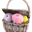 Stock Photo: Multicolored clews in wicker basket isolated on white