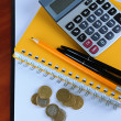 Foto Stock: Office supplies and money close up