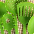 Plastic kitchen utensils on fabric background — Stock Photo #37294301