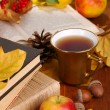 Books and autumn leaves on wooden table close-up — Stock Photo #37294387
